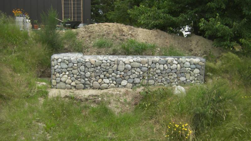 Our 3 to 8 inch cobble rock being used in a steel gabion cage for a homeowner.