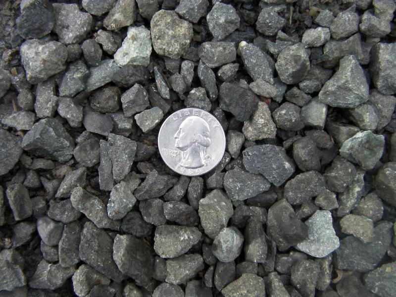 5/8th minus dark gray basalt with quarter to help show approx size.