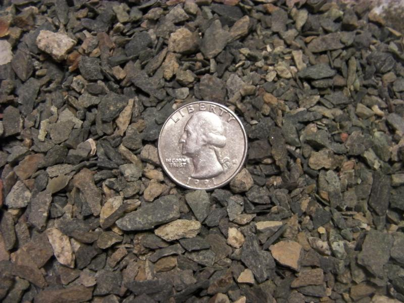 3/8th Minus Crushed Rock with fines.  Quarter to help show size.