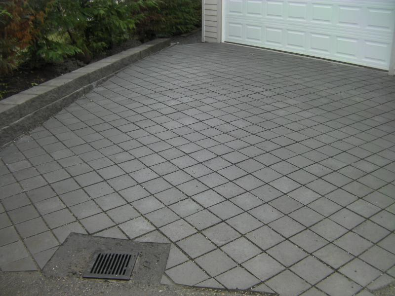 Pervious Paver Driveway with storm drain installed at bottom of slope.